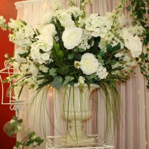 ALL_AROUND_FLORAL_ARRANGEMENT_IN_URN_ON_PEDESTAL