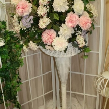 FLORAL ARRANGEMENT IN WICKER BASKET